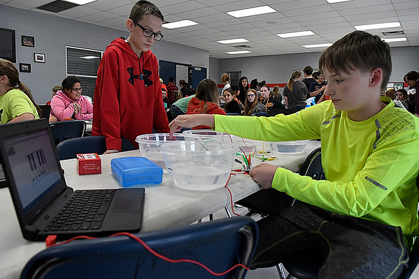 Braeden Plummer (sitting) and Hudson King demonstrate their electronic piano during Innovation Week at Chisholm Meddle School. (Billy Hefton / Enid News & Eagle)