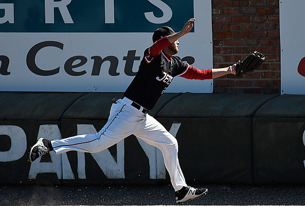 NOC Enid'sMatt Conerly makes a running catch on the warning track against MCC Longview Saturday February 25, 2017 at David Allen Ballpark. (Billy Hefton / Enid News & Eagle)