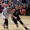 Pond Creek-Hunter's Tyra Peck drives to the basket against Garber's Jenni Beebe during the consolation finals of the class A area playoff tournament at the Central National Bank Center Saturday February 25, 2017. (Billy Hefton / Enid News & Eagle)