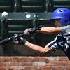 Enid Majors' Camden Kauk pops up a bunt attempt  against Newton, Kansas June 29, 2017 at David Allen Memorial Ballpark. (Billy Hefton / Enid News & Eagle)