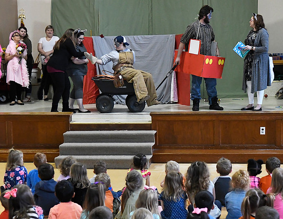 """Early childhood and elementary teaching students from NWOSU Enid perform """"Three Little Wolves and the Big Bad Pig"""" for students at Cimmaron Montessori School Tuesday April 11, 2017. (Billy Hefton / Enid News & Eagle)"""
