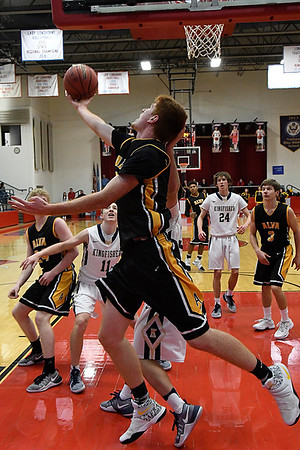 Alva's Grant Ritter goes under the basket for a shot against Kingfisher during the finals of the Wheat Capital Basketball Tournament Saturday January 7, 2017 at Chisholm High School. (Billy Hefton / Enid News & Eagle)