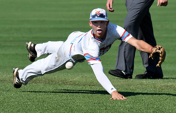 DBat Gowins' Bobby Witt, Jr. dives for a ball against the SW SHockers Red during the Connie Mack Regional Tournament Tuesday July 18, 2017 at David Allen Memorial Ballpark. (Billy Hefton / Enid News & Eagle)