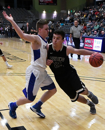 Seiling's Dalton Gore drives to the basket against Arapaho-Butler's Austin Gass during the consolation finals of the class A area playoff tournament at the Central National Bank Center Saturday February 25, 2017. (Billy Hefton / Enid News & Eagle)