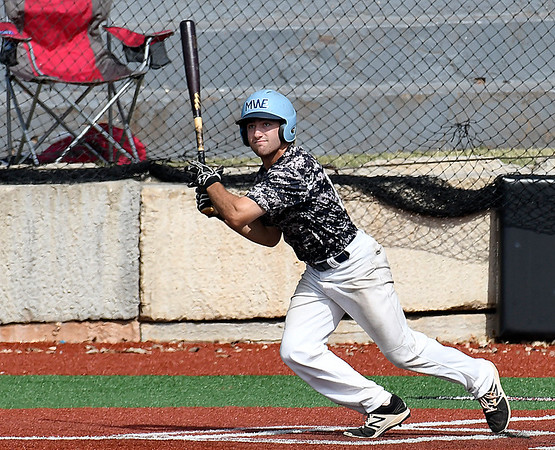 Enid Majors' Seth Graves connects on a base hit against Batters Box Gray at NOC's Failing Field Saturday June 17, 2017 during the Connie Mack Regional Qualifing Tournament. (Billy Hefton / Enid News & Eagle)