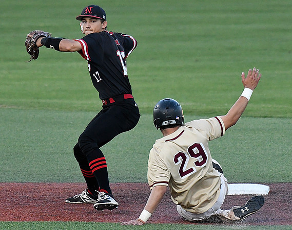 NOC Enid's T.J. Black steps aside of Redlands CC's Michael Oyervides to complete a double play during the Region 2 tournament Saturday May 13, 2017 at David Allen Memorial Ballpark. (Billy Hefton / Enid News & Eagle)
