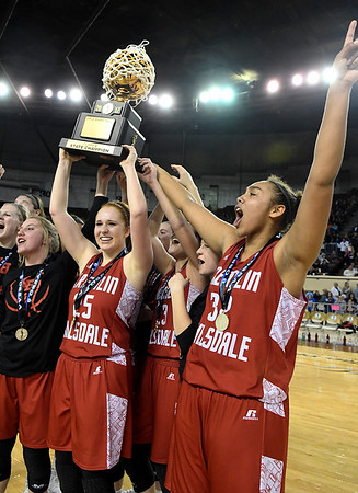 Kremlin-Hillsdale's Kalli Rundle (25) holds up the state championship trophy following a 53-46 win over Lomega in the class B state championship game Saturday March 4, 2017 at the State Fair Arena in Oklahoma City. (Billy Hefton / Enid News & Eagle)
