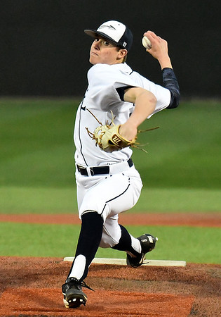 Enid's Mason Skrimager delivers a pitch against Sand Springs Tuesday March 7, 2017 at David Allen Ballpark. Skrimager took a no-hitter into the 7th inning before giving up two hits in the Plainsmen's 5-1 win. (Billy Hefton / Enid News & Eagle)
