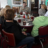 Garfield County deputy, Matt Ousley, visits with a table of ladies Vencl Saturday February 25, 2017 during a meet and greet at Teacups and Treasures in Garber. The town of Garber has contracted with sheriff's office for it's law enforcement. (Billy Hefton / Enid News & Eagle)