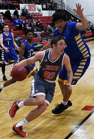 NOC Enid's Ty Lazenby dribbles pass Eastern's Julian Stands Thursday February 16, 2017 at the NOC Mabee Center. (Billy Hefton / Enid News & Eagle)