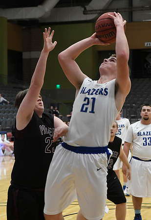 Cimarron's Garrett DeHaas shoots over Pioneer's Ben Schmidt during the semi-finals of the 93rd Skeltur Conference Basketball Tournament Thursday January 19, 2017 at the Central National bank Center. (Billy Hefton / Enid News & Eagle)