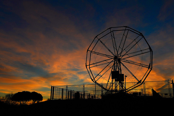 The skelton of the ferris wheel at Meadowlake Park is silhouetted by the sunset Wednesday February 1, 2017. (Billy Hefton / Enid News & Eagle)