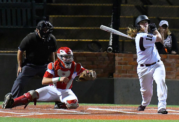 Pioneer's Gunner Coffey hits a single against Chisholm during the championship game of the Merrifield Office Plus Invitational Saturday April 15, 2017 at David Allen Memorial Ballpark. (Billy Hefton / Enid News & Eagle)