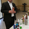 Erik Smoot, of the ABLE Commission, holds an alcohol product during a training session Wednesday January 25, 2017 at the Garfield County Sheriff Department. (Billy Hefton / Enid News & Eagle)