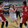 Lomega's Maci Mendell splits Kremlin Hillsdale defenders Jazzy Stubblefield and Rebecca Wasson as she drives towards the basket during the finals of the Cherokee Strip Conference Basketball Tournament Saturday january 21, 2017 at the Chisholm Trail Expo Center. (Billy Hefton / Enid News & Eagle)