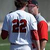 NOC Enid coach, Raydon Leaton, talks to Josh Rutland during a game against Ellsworth CC Thursday March 9, 2017 at David Allen Ballpark. (Billy Hefton / Enid News & Eagle)