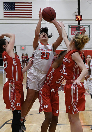 NOC Enid's Alenandra Greenhoward puts up a shot against a trio of NOC Tonkawa defenders Thursday February 9, 2017 at the NOC Mabee Center. (Billy Hefton / Enid News & Eagle)