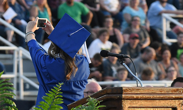 Abby Gwin takes a selfie with her classmates following her valedictory address during commencement exercies Thursday May 25, 2017 at D. Bruce Selby Stadium. (Billy Hefton / Enid News & Eagle)