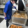 Dawson Dickson fries chicken during culinary arts class at Autry Technology Center Wednesday February 15, 2017. (Billy Hefton / Enid News & Eagle)