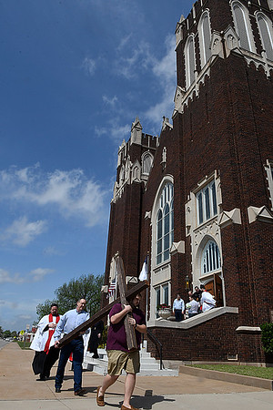 Worshipers leave First Presbyterian Church during a Good Friday processional April 14, 2017. (Billy Hefton / Enid News & Eagle)