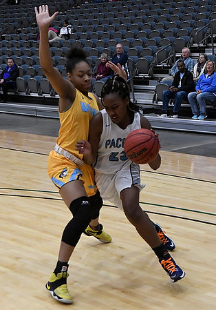 Enid's Johnetta Washington drives too the basket against Putnam City West's Zaniya Nelson Tuesday February 14, 2017 at the Central National Bank Center. (Billy Hefton / Enid News & Eagle)