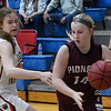 Pioneer's Kennedy Cassody drives to the basket against OBA's Elizabeth Price Tuesday February at the OBA gym. (Billy Hefton / Enid News & Eagle)