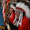 Members of the Kiowa Black Leggins Honor Society present the colors during Memorial Day ceremonies at the Woodring Wall of Honor Monday May 29, 2017. (Billy Hefton / Enid News & Eagle)
