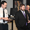 Dr. Richard VeVaughn applauds for Firefighter of the Year, Lt. Josh Sandwick (left) and Police Officer of the Year Detective Shawn Ramsey, during an awards presentation Thursday February 2, 2017 at the Enid Police Department. (Billy Hefton / Enid News & Eagle)