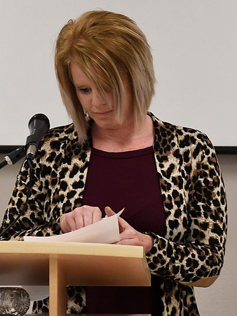 Amy Deeds shuffles papers while giving the keynote address during the 26th Annual Crime Victims' Vigil Tuesday April 4, 2017 at the YWCA Enid. (Billy Hefton / Enid News & Eagle)