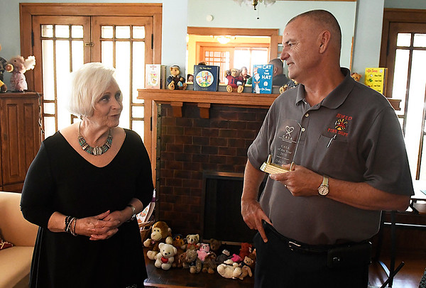 Carole Wade visits with Corbin Baker after he was named CASA of the Year Wednesday May 17, 2017. (Billy Hefton / Enid News & Eagle)