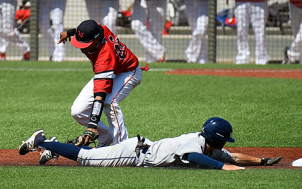 NOC Enid's Carlos Andujar tags out Rose State's Dru Barrier trying to steal second base Thursday March 23, 2017 ar David Allen Ballpark. (Billy Hefton / Enid News & Eagle)