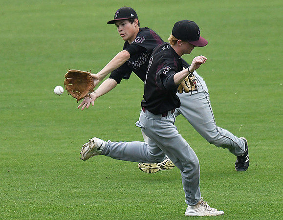 Pioneer's Layken Young moves out of the way as Chris Faw Faw makes a catch in centerfield Watonga during the opening game of the Merrifield Office Supply Tournament Thursday April 13, 2017 at David Allen Memorial Ballpark. (Billy Hefton / Enid News & Eagle)