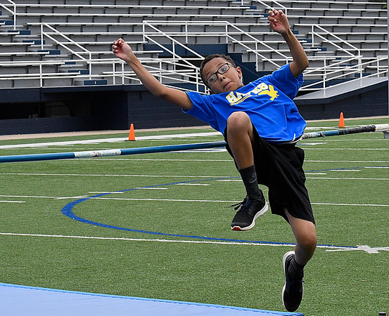 Jamison Washington from Hayes Elementary with the winning jump in the high jump during the 77th Annual Kiwanis Little Olympics Thursday May 11, 2017 at D. Bruce Selby Stadium. (Billy Hefton / Enid News & Eagle)