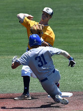 Phoenix CC's Casey Dunlap throws over Murray State's Ricky Silvestri for a double play Monday May 29, 2017 during the 2017 NJCAA DII World Series at David Allen Memorial Ballpark. (Billy Hefton / Enid News & Eagle)
