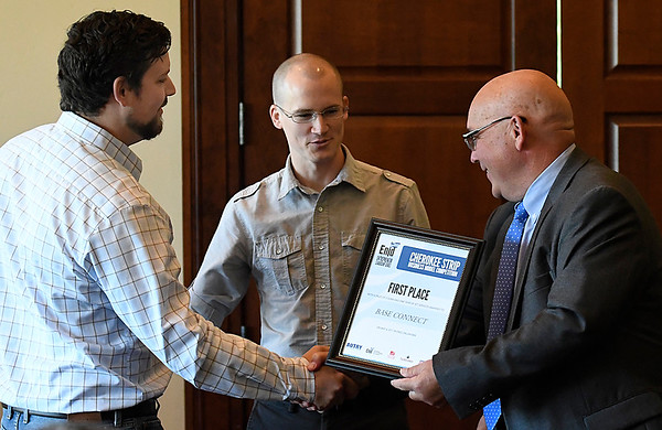 Autry Technology Center superintendent, Brady McCullough (right), presents Chase Williams (left) and Tony Weedn with the first place award in the Cherokee Strip Business Model Competition during a luncheon Thursday May 4, 2017 at the Oakwood Country Club. (Billy Hefton / Enid News & Eagle)