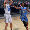 Enid's Emily Angleton gets by Lawton Ike's Delacia Brown for a shot Saturday January 28, 2017 at the Central National Bank Center. (Billy Hefton / Enid Nedws & Eagle)