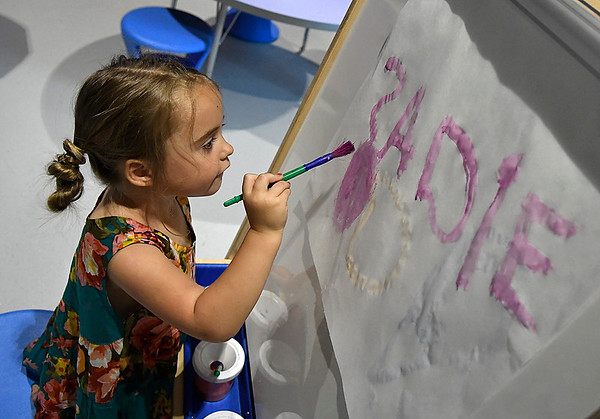 Sadie Shepherd paints at the art exhibit at Leonardo's Children's Museum Saturday June 10, 2017 during the grand opening of the new exhibits. (Billy Hefton / Enid News & Eagle)