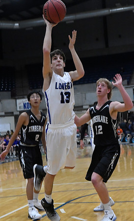 Lomega's Kaleb Turner shoots against Timberlake's Utah Bishard during the finals of the Cherokee Strip Conference Basketball Tournament Saturday january 21, 2017 at the Chisholm Trail Expo Center. (Billy Hefton / Enid News & Eagle)