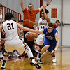 Cherokee's Caleb Roberts and Davion Walls try to trap Kade Wheeler of Waukomis February 10, 2017 during the opening round of the district tournament at Ringwood High School. (Billy Hefton / Enid News & Eagle)