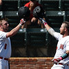 NOC Enid's Matt Conerly (right) is greeted at home plate by Wesley O'Neill after hitting a homerun against NOC Tonkawa during an elimination game of the Region 2 tournament Sunday May 14, 2017 at David Allen Memorial Ballpark. (Billy Hefton / Enid News & Eagle)