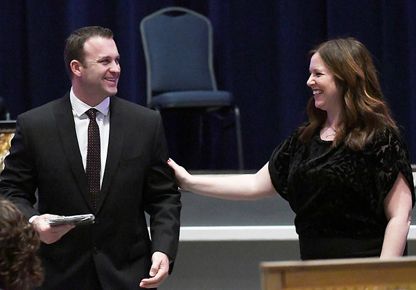 Molly Shepherd shares a laugh with Darren Jones after presenting his the award for Volunteer of the Year during Leonardo's Children's Museum annual awards dinner Thursday March 9, 2017 at the Central National Bank Center. (Billy Hefton / Enid News & Eagle)