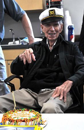 Glenn Semke enjoys a bite of birthday cake during his 100th birthday celebration Monday at the Denny Price Family YMCA. (James Neal / Enid News & Eagle)