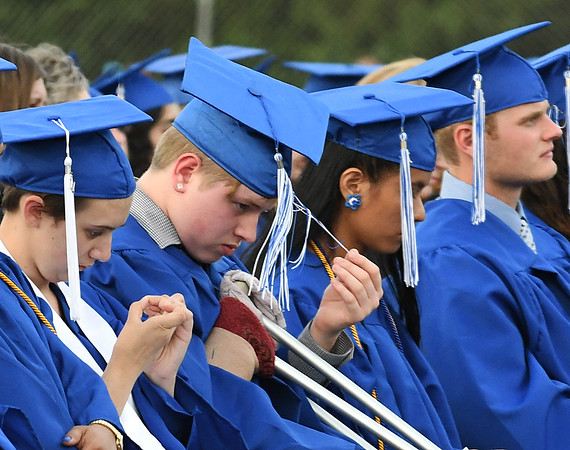 Member of the Enid High School Class of 2017 listen to speeches during commencement exercies Thursday May 25, 2017 at D. Bruce Selby Stadium. (Billy Hefton / Enid News & Eagle)