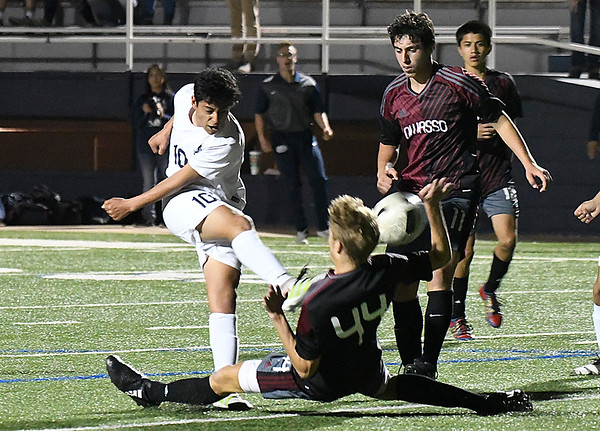 Enid's Ivan Delgadillo gets a shot off against Owasso Friday April 14, 2014 at D. Bruce Selby Stadium. (Billy Hefton / Enid News & Eagle)