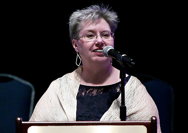 Julie Baird, executive director Leonardo's Children's Museum, gives her director's report during the annual awards dinner Thursday March 9, 2017 at the Central National Bank Center. (Billy Hefton / Enid News & Eagle)