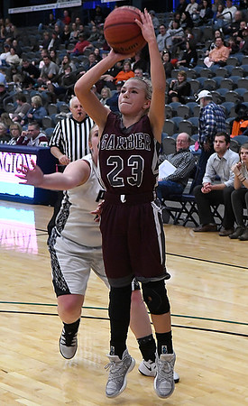 Garber's Halie Schovanec gets by Pond Creek-Hunter's Jaicee Stinson for a shot during the finals of the 93rd Skeltur Conference Basketball Tournament Saturday January 21, 2017 at the Central National Bank Center. (Billy Hefton / Enid News & Eagle)