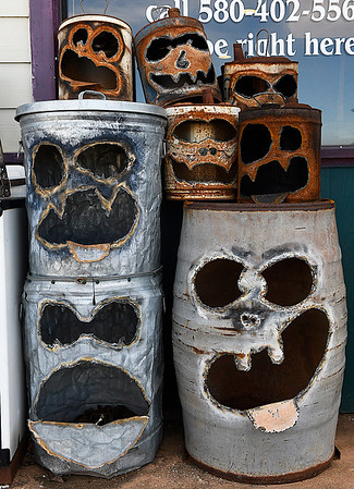 Jack-o-lantern faces cut into metal cans by Kelly Kurtz at Antiques-n-Things in Lahoma Saturday january 28, 2017. (Billy Hefton / Enid News & Eagle)