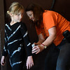 """Autumn Rogers tries to take a peek as instructor, Terri Galer, paints stripes on her costume for the Gaslight Kids' Drama Camp production of the """"Lion King Kids"""" at the Gaslight Theater. (Billy Hefton / Enid News & Eagle)"""