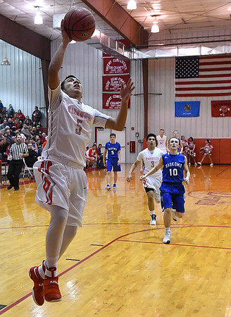Ringwood's Carlos Aguilar scores a fastbreak basket against Waukomis February 2, 2017. (Billy Hefton / Enid News & Eagle)