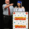 Lincoln Academy principal, Jarry Hillman, shares a laugh with Lauryn Antilla during her speech during Senior Appreciation Night Tuesday May 16, 2017. (Billy Hefton / Enid News & Eagle)